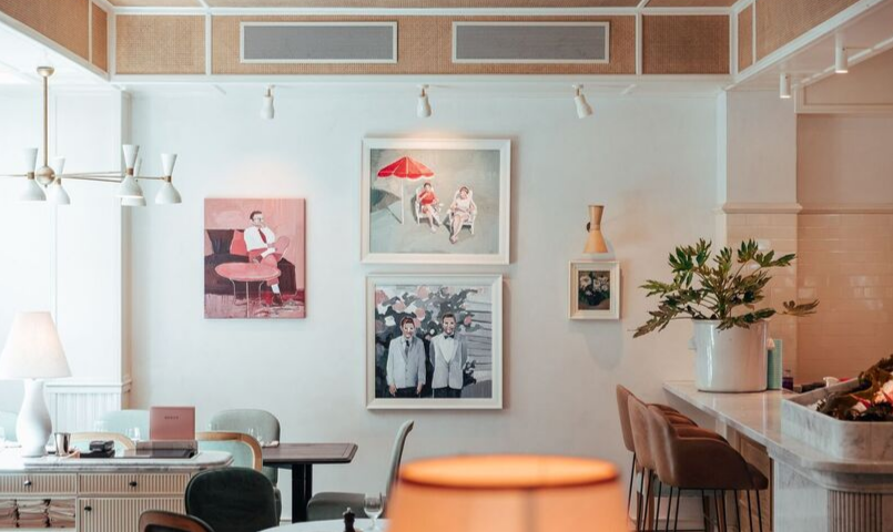 Interior shot of the wall art and welcome lounge at Bert's Brasserie, Newport