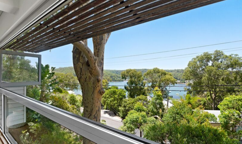 Balcony of a Belle Property Escapes luxury holiday rental overlooking the water at Hardy's Bay