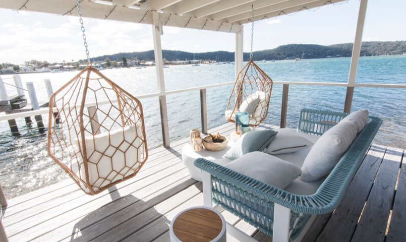 Outdoor deck and entertaining space of a Belle Property Escapes luxury holiday rental on the water at Wagstaffe