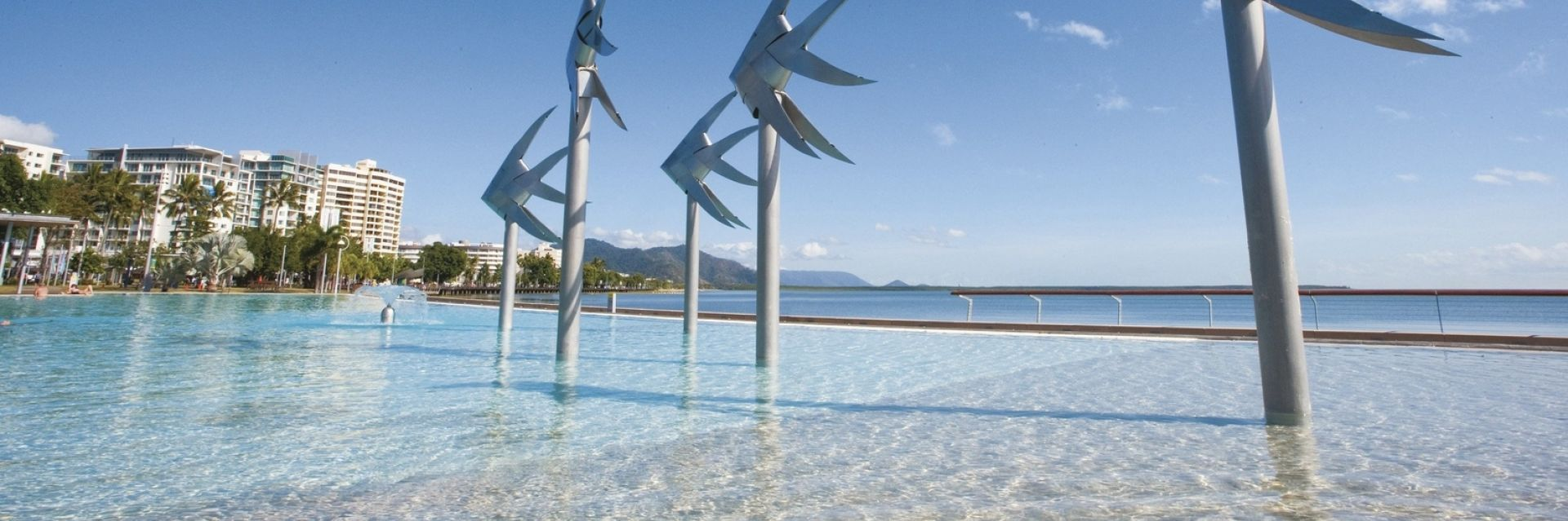Cairns Esplanade Swimming Lagoon featuring the famous fish sculptures. Photo credit: Tourism and Events Queensland.