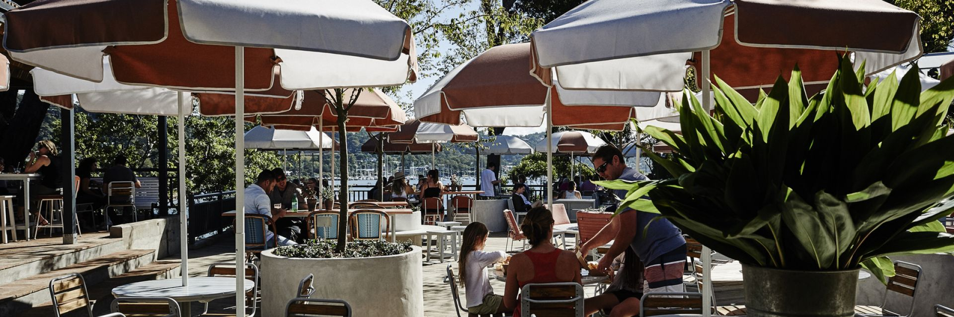 Outdoor drinking and dining deck at The Newport on a sunny day